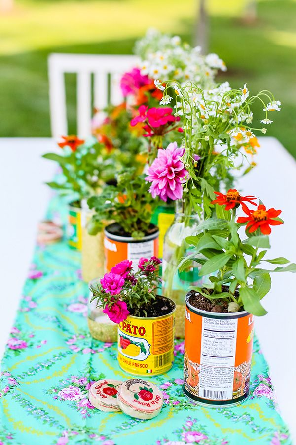 Use old tin cans and wild flowers to create a casual, summery tablescape for your summer solstice or garden party.