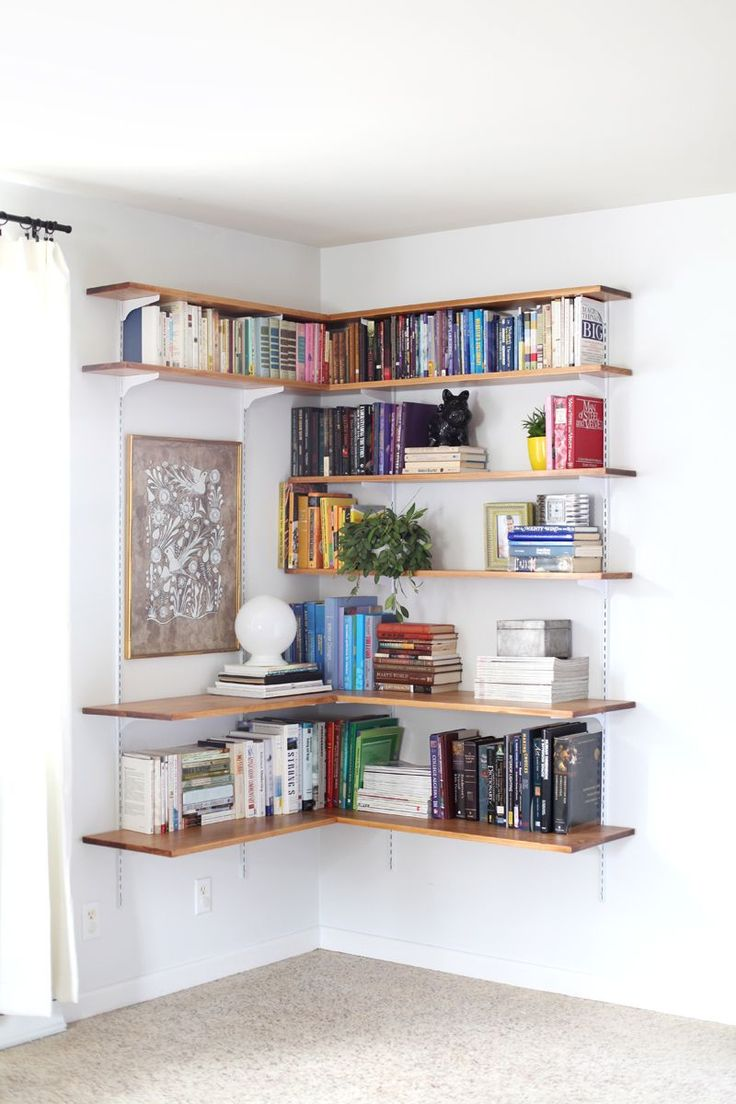 Corner bookcase! Great DIY.