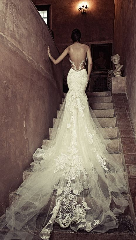 Sophisticated low open back strapless wedding dress with embroidered tulle bridal train; Featured Dress: Julia Kontogruni