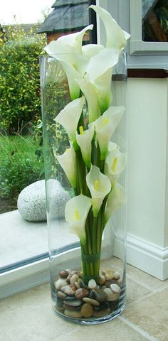 calla lilies in tall vase, trim to different heights