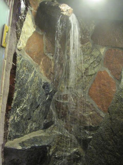 rock waterfall shower, who needs a shower head!