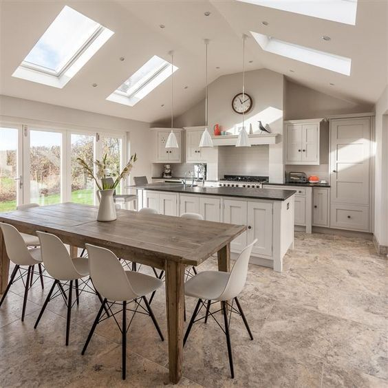 Incredible grey kitchen painted in Farrow and Ball Ammonite and Purbeck Stone. Full details on Modern Country Style