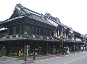 """Kawagoe (川越) is located about 30 minutes by train from central Tokyo and is suitable as a day trip destination. Its main street, lined with Kurazukuri (clay-walled warehouse-styled) buildings, retains an ambience reminiscent of an old town from the Edo Period (1603-1867) and allows us to imagine the streets from past centuries. Thereby, Kawagoe became known as """"Little Edo""""."""
