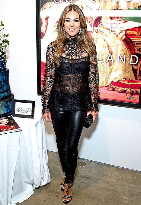 Elizabeth Hurley premiered the second season of The Royals in NYC on Sunday, Nov. 9, in a sizzling leather and lace outfit; see the photos of her with the E! series cast here!