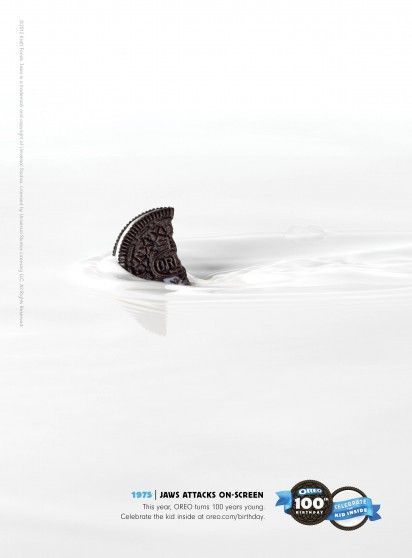 "The first picture is half Oreo swimming in the milk as a shark in the ocean. It is creative to memorize the movie ""Jaws"" by Steven Allan Spielberg."
