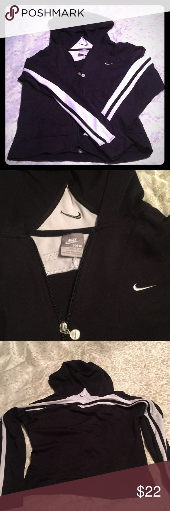 Nike zip up jacket! Women's small nike zip up light jacket! Black and white!  Great for a light jacket for the gym!! Nike Jackets & Coats