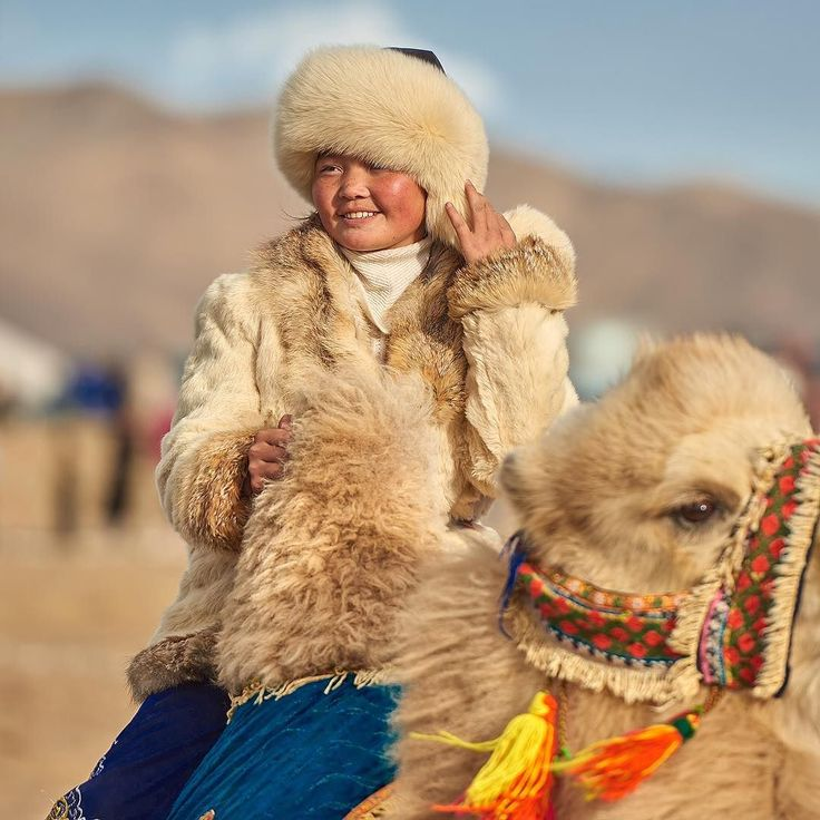 Follow me on Instagram http://ift.tt/2eULXIY Grace beauty and camels not a common association except when youre surrounded Kazakhs  #mongolia #photoadventure #remotelocations #explore #withintheframe #kazakh #eaglefestival #travel #wanderlust #travelphotography #traveltheworld #everywhichaway #fromtheworld