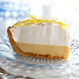 Lemon Cream Pie from Eagle Brand® Sweetened Condensed Milk 3 large egg yolks 1 (14 oz.) can Eagle Brand® Sweetened Condensed Milk 1/2 cup lemon juice 1 (6 oz.) prepared graham cracker crust Frozen whipped topping, thawed or whipped cream Grated lemon peel Bake 30minutes at 325