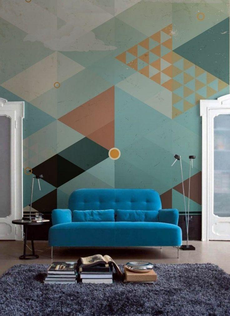 peinture décorative dessin géométrique de style vintage et canapé bleu