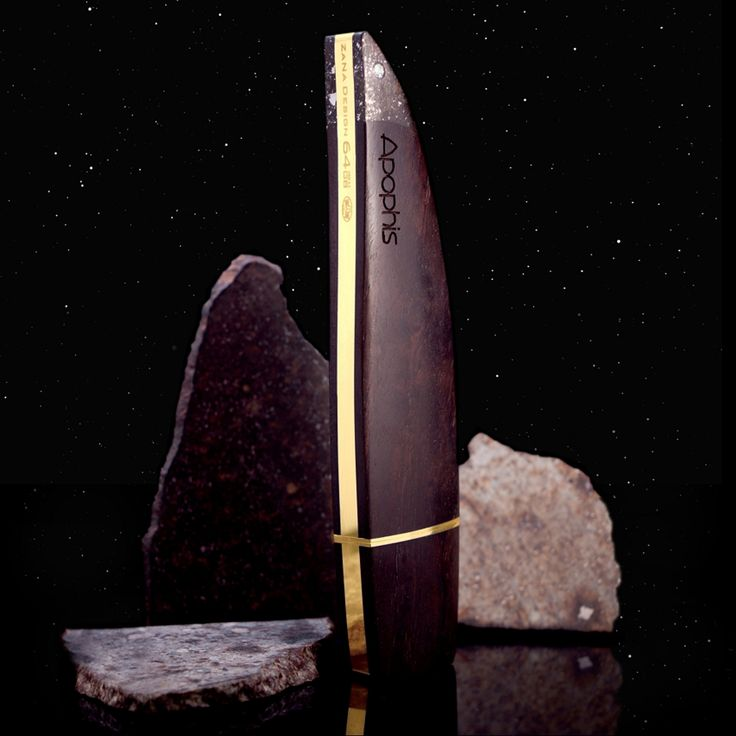 "Apophis is the highest quality usb flash drive designed for the most demanding Clients. Thanks to the use of the authentic and certified meteorite this usb flash drive refers to ""Apophis"",  the famous planetoid. The high-purity ""VS1"" diamond's 0,04ct is an excellent complement for the 4,5 billion years old meteorite. The casing of the Apophis is made of 200 years old African Black Wood  considered to be the most luxurious wood in the world. The whole device is covered with 18-carat gold."