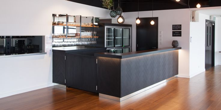 Marina Bar, Tairua featuring Melteca Black in Puregrain finish (counter front), Melteca Oiled Legno (shelving) and Formica laminate in Black (back countertop)