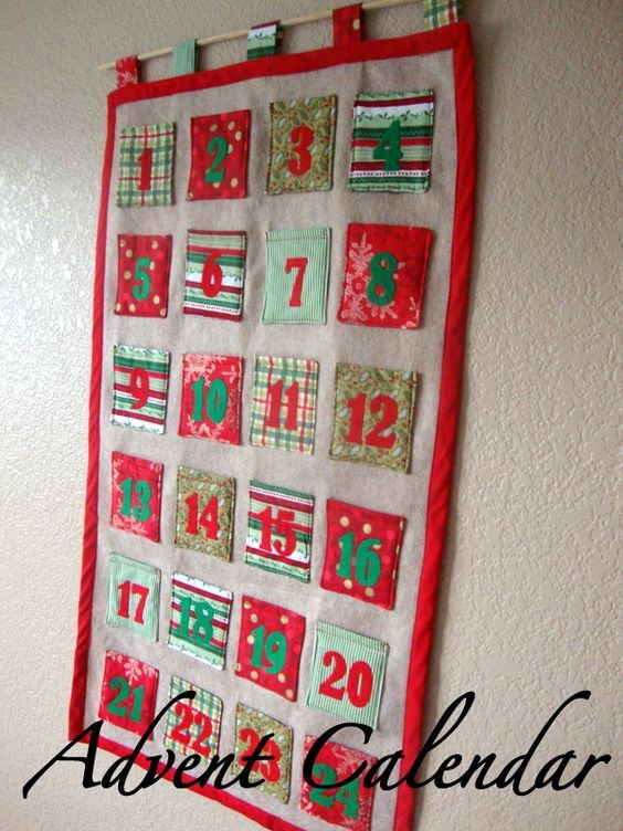 I had some leftover fabric from the stockings I made last Christmas so I browsed pinterest and came up with an advent calendar.  I didn't...