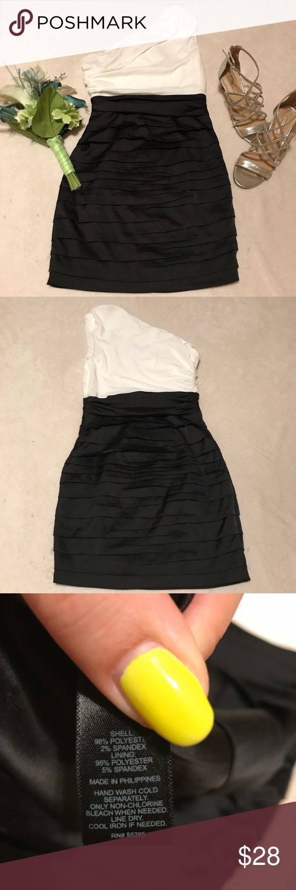 Black and White Ruched Cocktail Dress Classy black and white one sleeve cocktail dress in silky material. Side zipper on left side. Great condition. Express Dresses One Shoulder