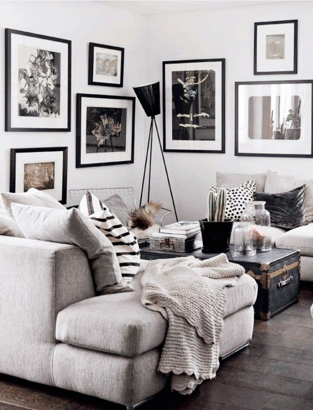 Monochromatic scheme with plenty of personality. The comfortable textures and asymmetry warm up the space. Arrangement of seating creates a good conversational area. I especially like the quirky trunk coffee table. Maybe a few too many pillows for my taste.