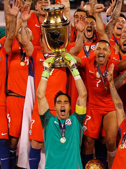 #COPA2016 #COPA100 Claudio Bravo of Chile raises the Copa America Centenario Trophy with his teammates behind him following the championship match between Argentina and...