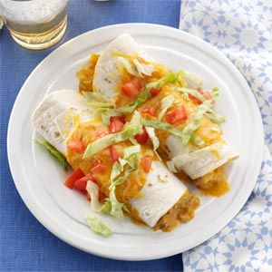 Queso Pork Enchiladas Recipe -My husband took these restaurant-style enchiladas to work, and now the guys always ask for them. They're rich and spicy, and you can prepare them with cooked chicken or beef, too. —Anna Rodriguez, Bethpage, New York