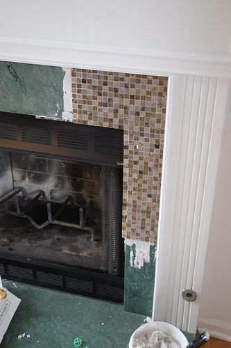 DIY tile over marble fireplace makeover- I wonder if I can talk my hubby into this?  Love it!