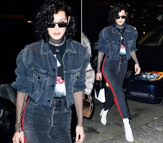 Bella Hadid  DOVE: New York  LOOK: Punk Rock. La modella ad un party nella grande mela in total denim e maglia con maniche a rete completano lo stile i capelli cotonati Anni 80.