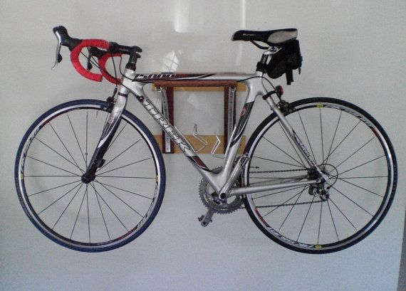 Bicycle rack made from used wheel rims & reclaimed wood.