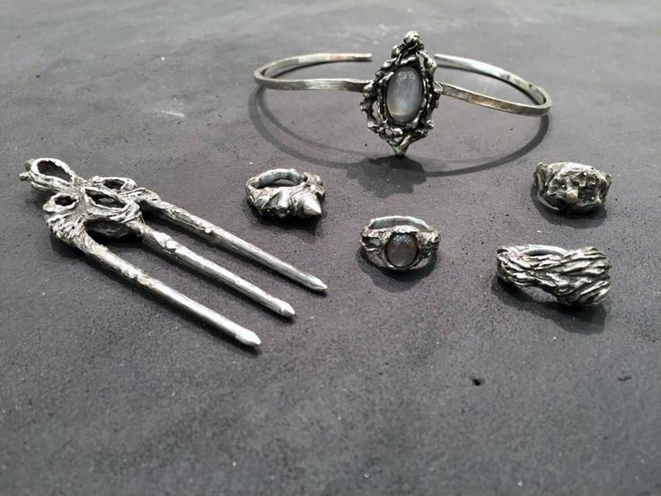 left to right - lamina hairpiece, sui ring, kuchi choker with grey moonstone, sachiel ring with labradorite, seele ring and ilium ring