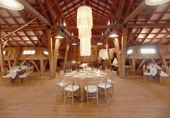 9+Ways+To+Light+Your+Reception. make a statement with one large paper chandelier over the couples table