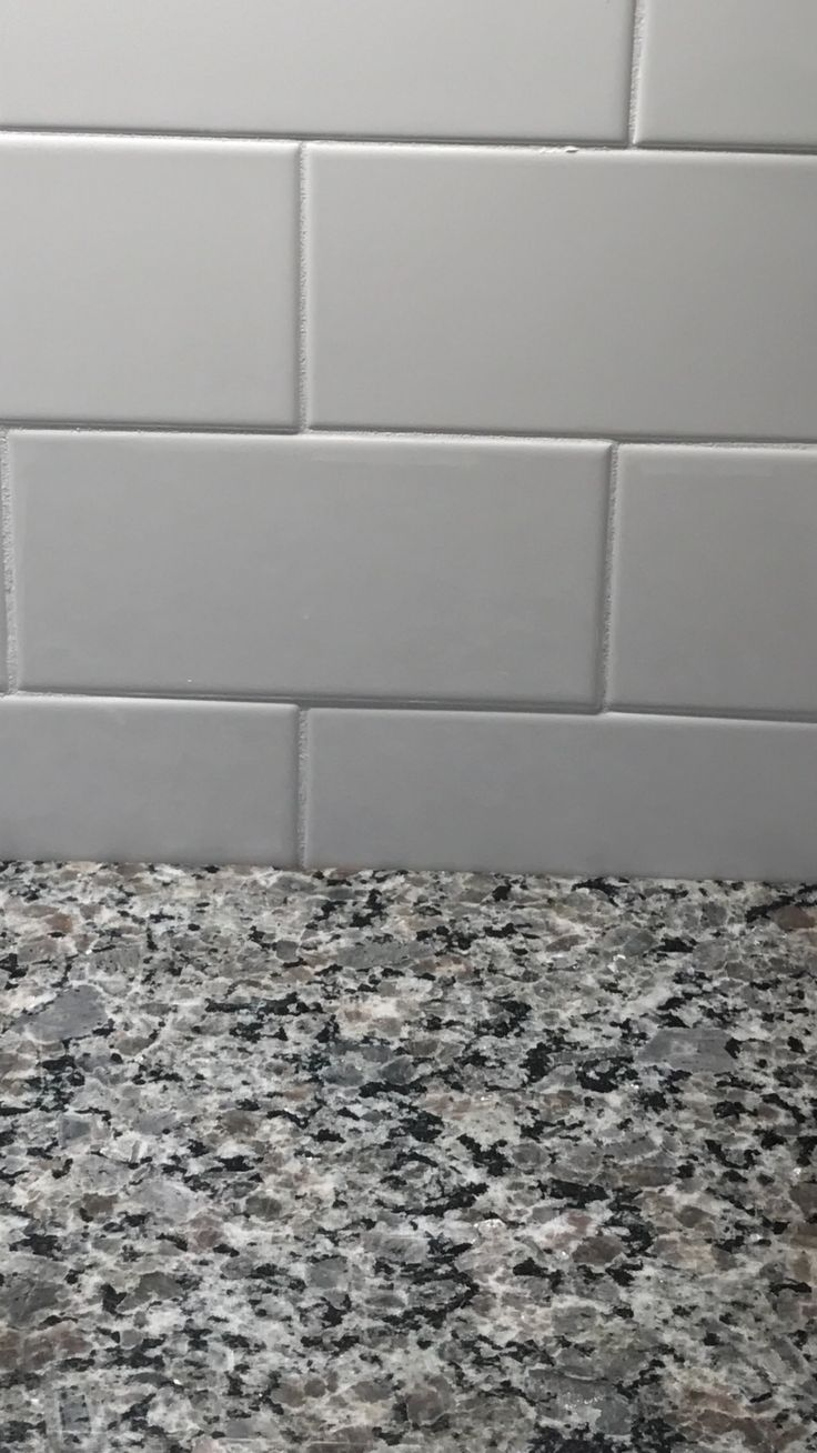 Close up of the Caledonia granite and light gray subway tile we will have in the kitchen