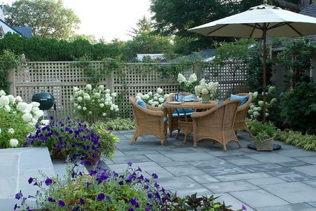 Patio for townhouse garden - When planning or designing a patio area for a small garden take into consideration that sometimes less is more. With the right materials and clever planting, even a small patio can feel more expansive. http://www.home-dzine.co.za/garden/garden-patiodesign.htm