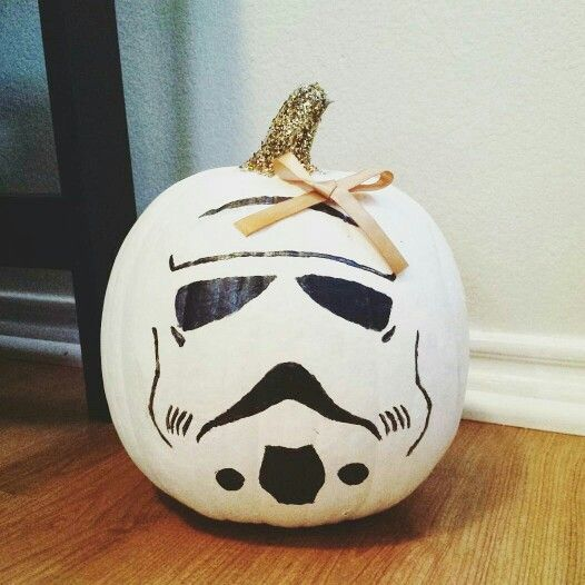 Starwars Stormtrooper pumpkin. This does not need a bow or a glitter stem. What is wrong with people