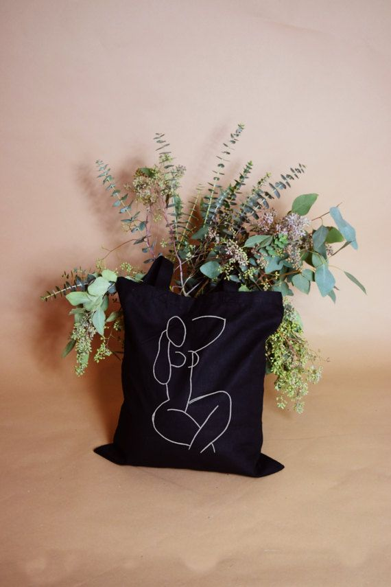artwork by henri matisse printed on a 100% cotton canvas tote!  tote bag also comes in a natural with black design version.  measures 14 x 16