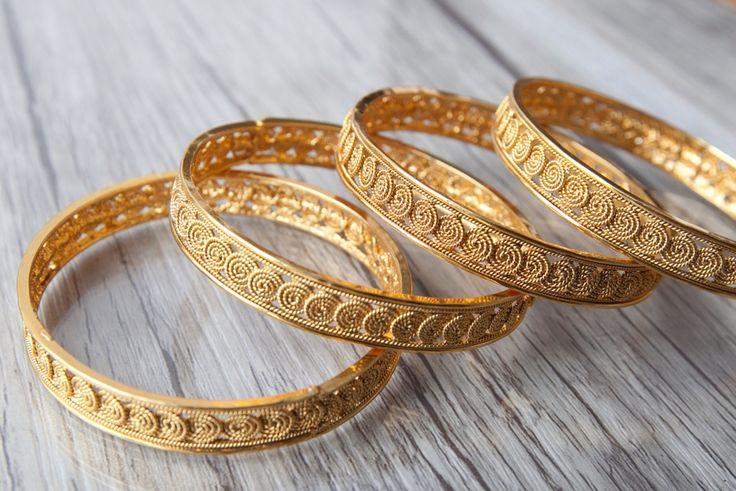 Feeling a little traditional ?? Check out this stunning coin bangle set with a modern swirly twist.  Visit us at www.aavarna.com  #kada #indianwedding #wedding #jewelry #bollywood #indianfashion #shaadi #indianbride #hindubride #earrings #baju #jhumka #fashion #designinspiration #indianjewelery #bangles #onestopweddingshop #bridalwear #kundan #pearls #traditional #stunning #instafashion #armlet #aavarna #aavarnacollections