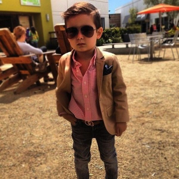 OMG cutest little boy ever. And such a well dressed kid too!