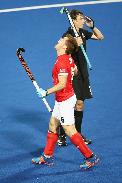 Henry Weir of Great Britain celebrates a Great Britain goal as Nick Wilson of New Zealand looks dejected during the men's pool A match…