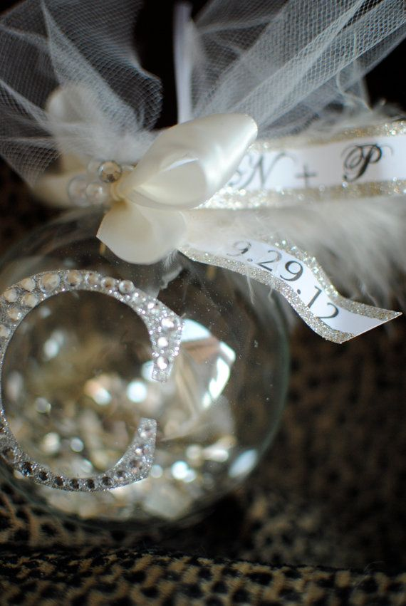 Make a Christmas ornament with stuff from your wedding to always have a keepsake during Christmas!!    Clear ornament, bouquet petals, etc. with Glitter Inital on the front. LOVE!