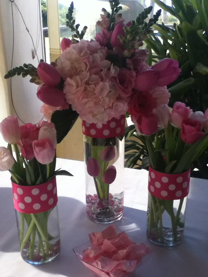 pink baby shower cake table more pink flower baby shower centerpieces