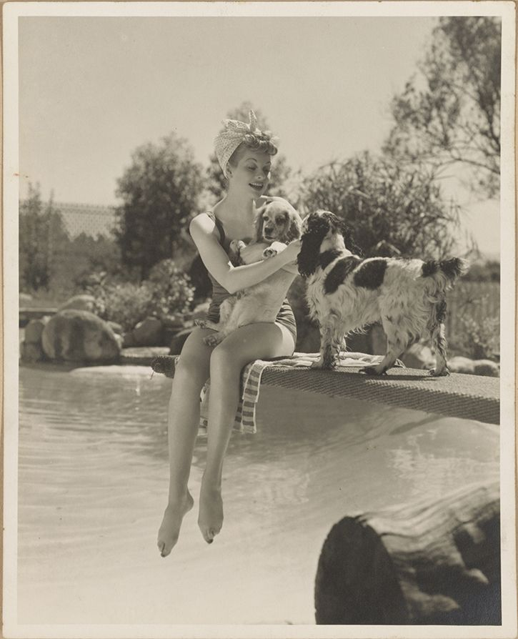 """Ball at the swimming pool at their Desilu """"ranch"""" in Chatsworth, California, ca. 1942. (012.00.00)"""