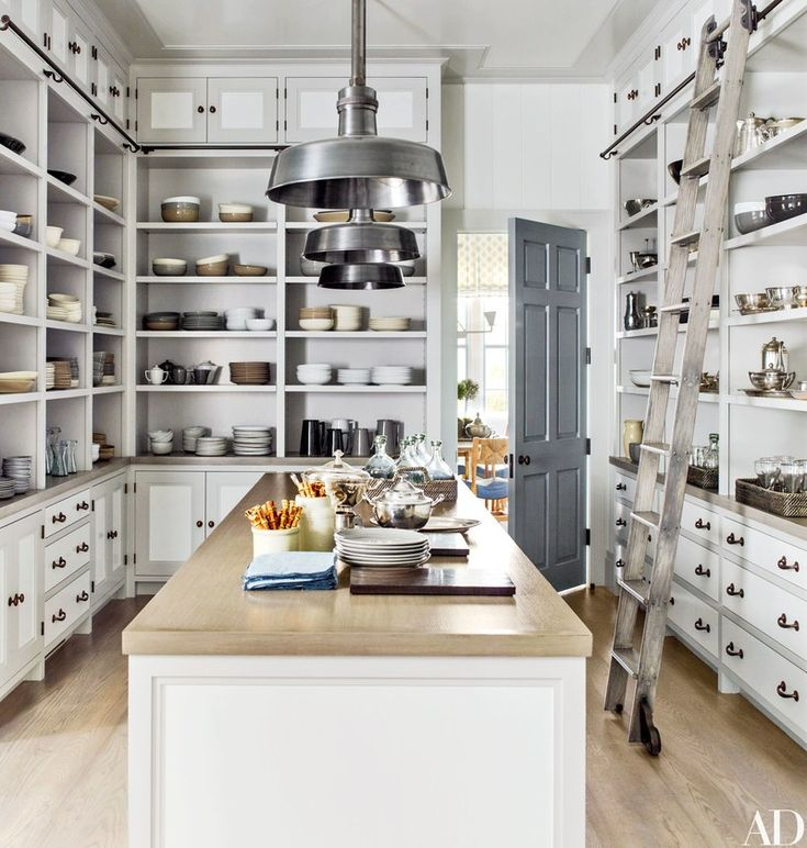 A dream pantry with a white oak ladder