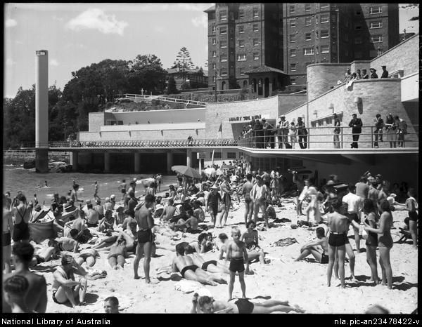 South end of Manly Beach, showing the shark tower, Manly Surf Pavilion and block of flats in 1939.