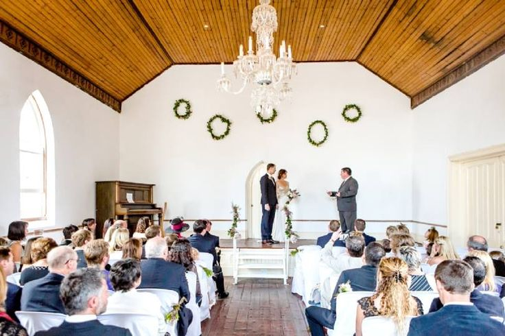 Karoo inspired wedding at Matjiesfontein, with touches of Zimbabwe.Proteas, fynbos, roses, flamelilies, blushing brides, succulents, night sky.. Wall wreaths. Event planner | Wedding planner | Florist | Floral designer | Cape Town