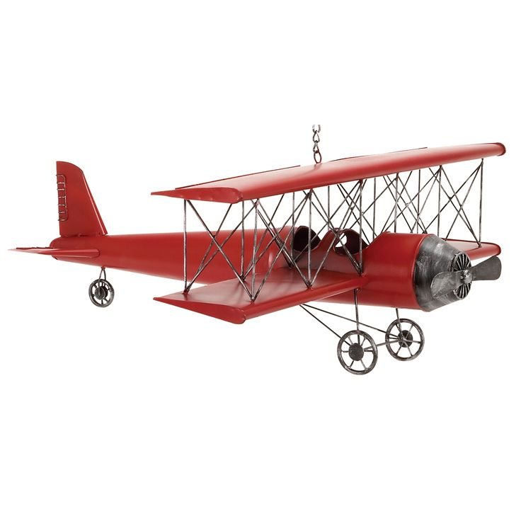 This antique toy replica bi-plane features a hand-painted finish. This collectible metal toy plane is created to look just like the original model.