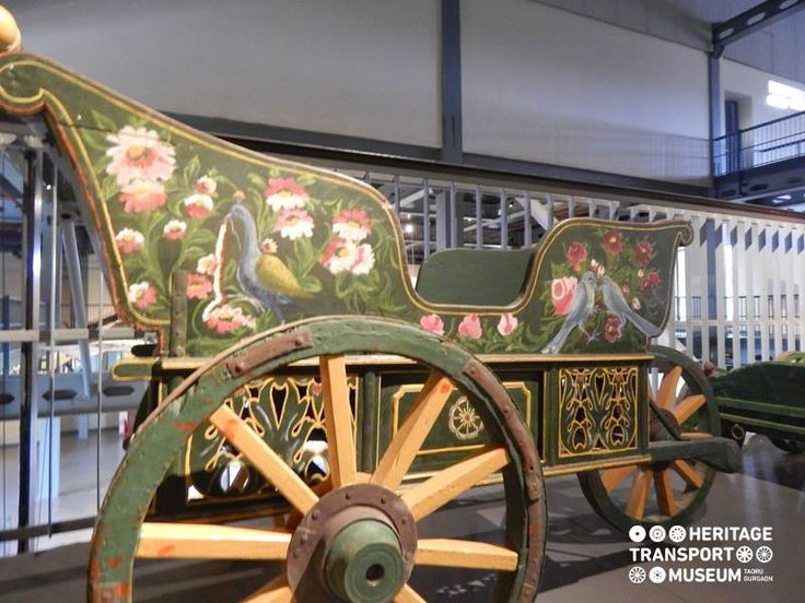 A baby pram of the olden days crafted with wood and beautifully decorated with hand painting! :)