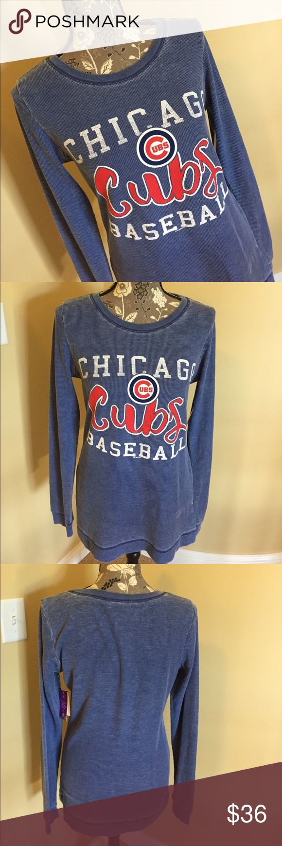 """NWT Chicago Cubs long sleeved top NWT Chicago Cubs long sleeved lighter weight waffle shirt size large. Super comfy. Chest 18"""", length 27 1/2"""", sleeves 26"""". Material poly, cotton, spandex blend. Touch by Alyssa Milano Tops Tees - Long Sleeve"""