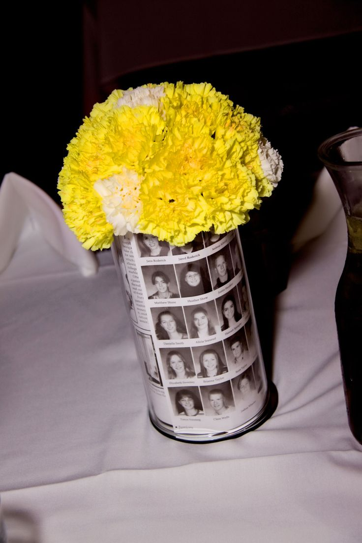 Carnations CAN be pretty!  Pinner did these centerpieces for a highschool reunion.     What you need: hurricanes, battery votives, half circle floral foam, carnations (about 25+ per vase), copies of whatever you want to put in the center.     I copied pages of our old yearbooks and simply inserted them into the vase with a little bit of tape.     Turn on votive and place in bottom of vase.    Place flowers on top. The flowers will create a natural ledge so they sit on top of the vase.