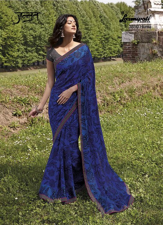 Excotic and Ravishing Navy Blue coloured Jute Patta Saree with its exceptional Floral Print which will give you a Casual look combined with Formal wear feel. It has been further formalised with Pashmina Lace and is alo carrying Black Jute Patta Blouse. www.laxmipati.com
