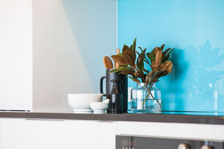 Coloured glass splashback in kitchen. - Shepperd Building Company