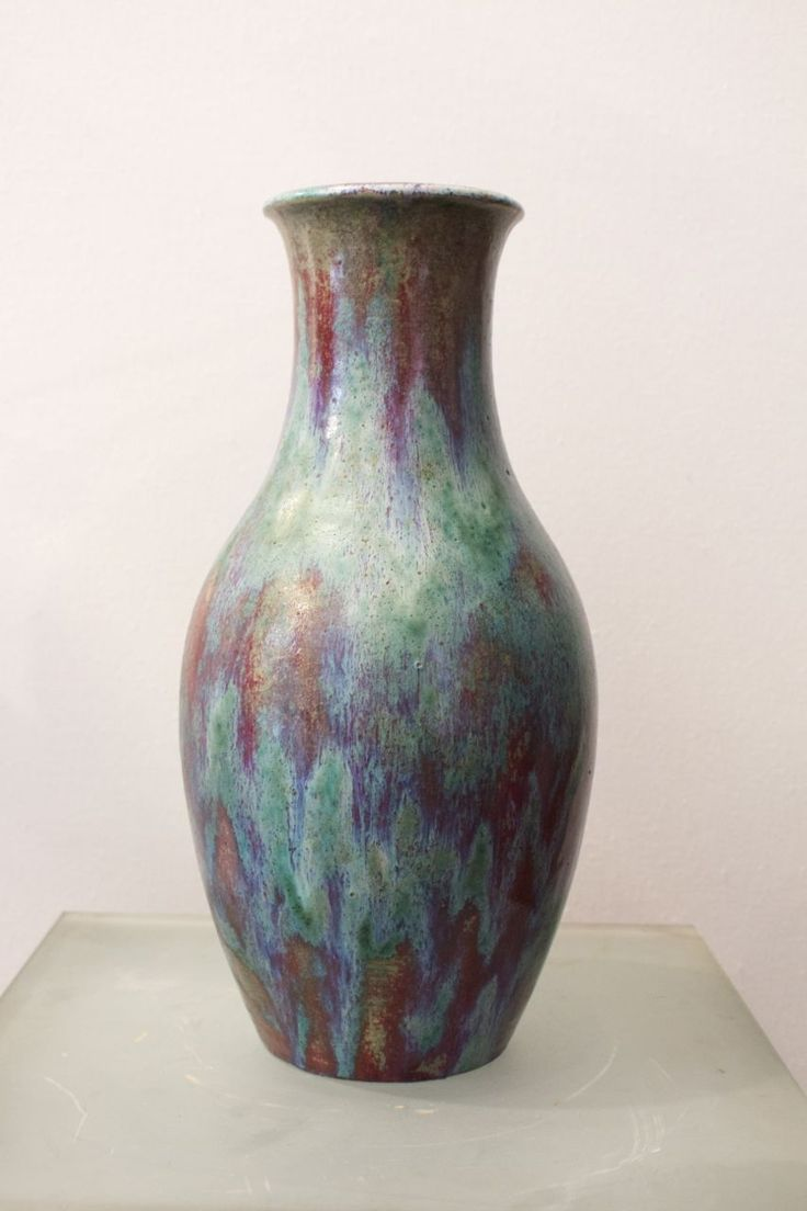 A Decoeur potbellied vase with long neck, circa 1906 - 1907, signed.