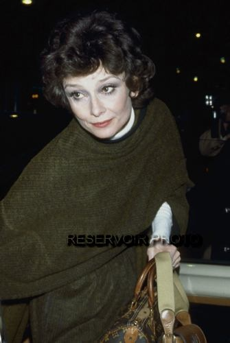 Audrey Hepburn photographed by Francis Apesteguy after a dinner at the apartment of her friend Capucine (Germaine Lefebvre) in Paris (France), on March 15, 1979. -Audrey was wearing Givenchy creations (mantle and skirt of dark green wool with black hem, of his haute couture collection for the Autumn/Winter 1978/79) and holding her handbags of Gucci and Louis Vuitton.