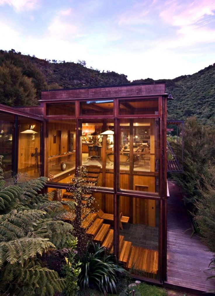 Pete Bossley Architects : Waterfall Bay House. Unique frame, love the windows and wood interior!
