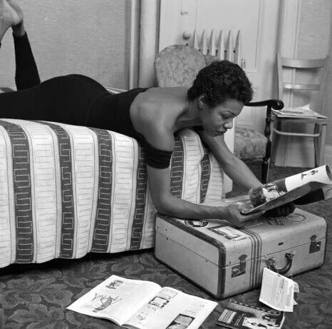 """Maya Angelou doing a little reading in her dressing room before her performance at the Village Vanguard in New York City. Long before she was a poet and writer and the icon we know today, Dr. Angelou was a dancer and a singer of folk and calypso songs (she recorded and album in 1957 called ""Miss Calypso"" and appeared in the film ""Calypso Heatwave"" that same year. This photo was taken by G. Marshall Wilson, who was a staff photographer at Ebony for 33 years.""-Vintage Black Glamour FB Page"