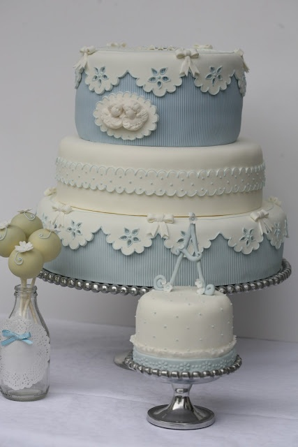 Fondant covered blue and white cameo cake. !!!!!!!! love the eyelet effect