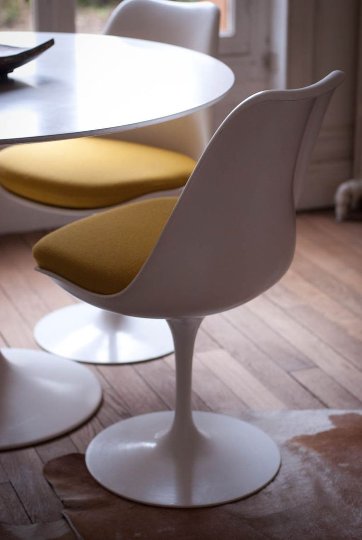 International Chair (Tulip Chair) -plastic material -cushioned seat -white skeleton and bright colored cushion